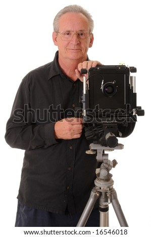 Senior photographer with a large format camera on tripod