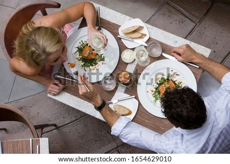 Couple dining in restaurant, overhead view #1654629010