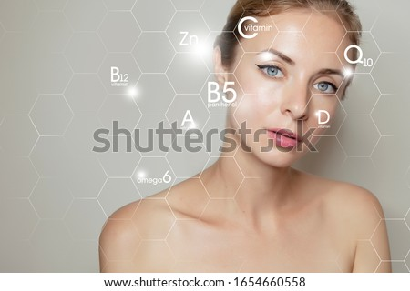 woman face portrait with graphic icons of vitamins and minerals for skin treatment #1654660558