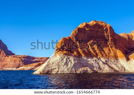 Tour on a tourist boat on an artificial reservoir Lake Powell. Antelope Canyon. Sunset. Grandiose cliffs - red sandstone outcroppings. Concept of active and photo tourism #1654666774