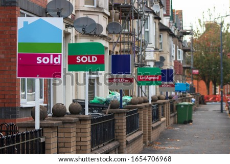 Property Sales. Estate Agents Sold Signs on UK Terraced Houses