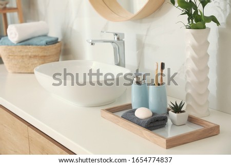 Countertop with sink and toiletries in bathroom. Interior design Royalty-Free Stock Photo #1654774837