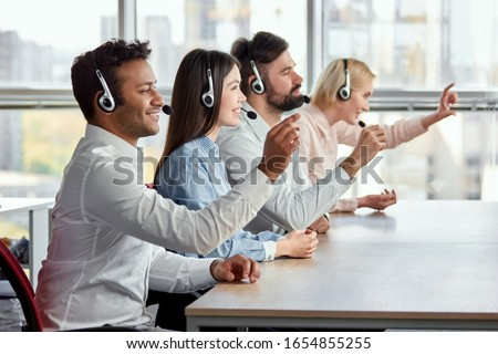 Working with invisible imaginary screen, resizing and swiping. People with headset in office sliding and swiping virtual screen, side view.