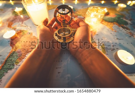 Top view female hands planning vacation equipped with world map and vintage nautical compass - Travel tour adventure lifestyle people and discovering destinations concept #1654880479