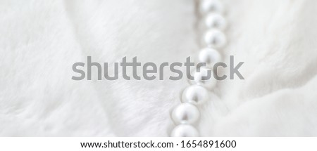 Jewelry branding, elegance and sale concept - Winter holiday jewellery fashion, pearl necklace on fur background, glamour style present and chic gift for luxury jewelery brand shopping, banner design #1654891600
