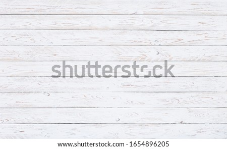 A surface of white worn out wooden boards in horizontal position. for vintage backgrounds, wedding invitations or spring motives #1654896205