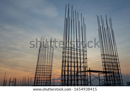 Steel reinforce in concrete column.Steel grid on the construction site.Reinforcement of concrete work. Using steel wire for securing steel bars with wire rod for reinforcement of concrete at sunset #1654938415