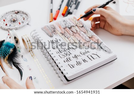 Hand lettering workspace artist on white background. paint, palette, watercolor, brushes, paper. Top view lettering. hand lettering quotes.  #1654941931