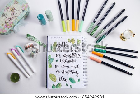 Hand lettering workspace artist on white background. paint, palette, watercolor, brushes, paper. Top view lettering. hand lettering quotes. #1654942981