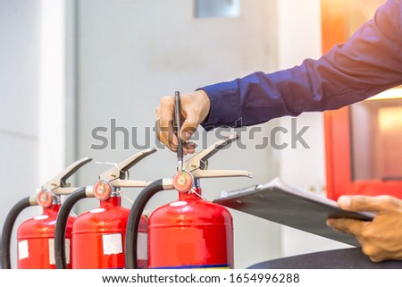 Engineer checking Industrial fire control system,Fire Alarm controller, Fire notifier, Anti fire.System ready In the event of a fire. #1654996288