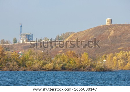 Autumn landscape, dark blue water, last warm days, river, trees, windy weather, yellow-red autumn leaves #1655038147