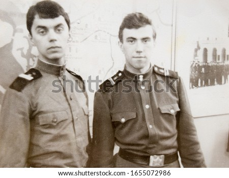USSR, LENINGRAD - CIRCA 1968: Vintage photo of two Soviet Army soldiers in Leningrad, USSR #1655072986