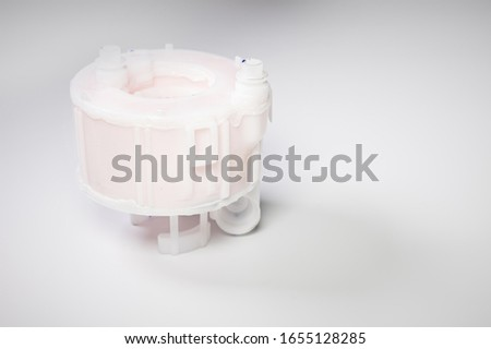 New spare part. Replaceable white plastic inner fuel filter on a gray gradient background #1655128285