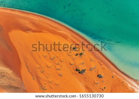 An aerial view of sand dunes and the beach in the Shark Bay region of Western Australia. Image captured shooting out of a Cessna with the door off. Royalty-Free Stock Photo #1655130730