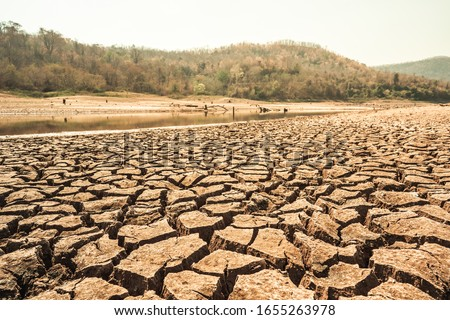 Blurred cracked earth, drought on hot climate on summer weather #1655263978