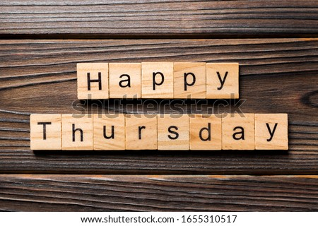 Happy thursday word written on wood block. Happy thursday text on wooden table for your desing, concept.