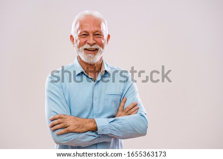 Portrait of cheerful senior man who is looking at camera and smiling. #1655363173