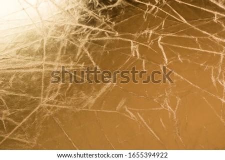 Gold wrinkled material. Background , wrinkled material. #1655394922