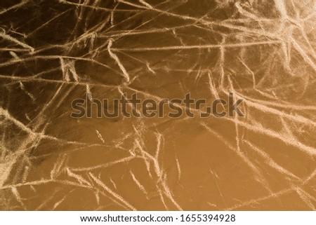 Gold wrinkled material. Background , wrinkled material. #1655394928