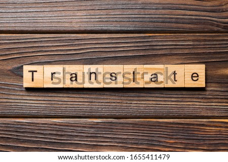 Translate word written on wood block. Translate text on wooden table for your desing, concept.