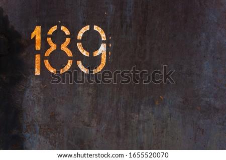 Metal Rust Background Metal Rust Texture. Beautiful unusual background. Rusted painted metal wall. Rusty old background with streaks of rust. Rust stains. #1655520070