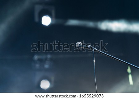 microphone on a dark stage #1655529073