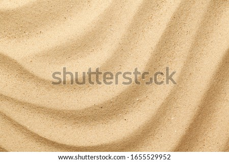Wavy sea sand background. Flat lay. Top view Royalty-Free Stock Photo #1655529952