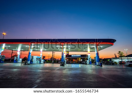 Ratchaburi, Thailand - February 2020 : View of PTT gas station at night, Ratchaburi Thailand. Select focus. #1655546734