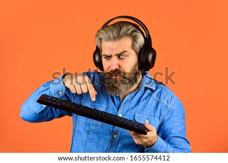 Man bearded hipster gamer headphones and keyboard. Gaming addiction. Graphics settings pushed to limit. Play computer games. Superior performance. Online gaming. Modern leisure. Run any modern game. #1655574412