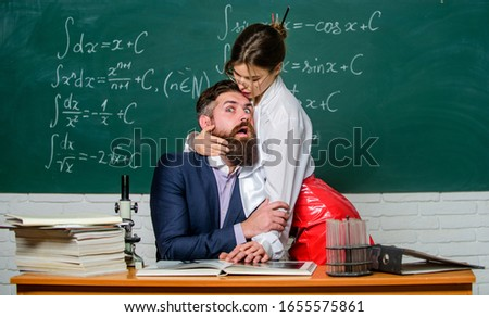 Help me. Authority abuse. Sexy woman dominating bearded man. Authority in relationship. Leadership and authority. Sensual student seduce teacher at lesson. Authority. Girls power. #1655575861