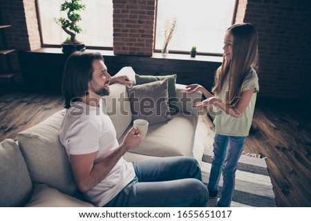 Profile photo of little adorable lady her handsome daddy sit comfy sofa telling secrets communicating drink hot beverage cup spend weekend time domestic house room indoors #1655651017