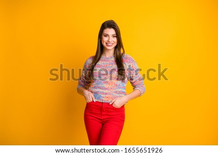 Portrait of content candid pretty girl enjoy spring holidays weekends put hands pocket wear modern pullover clothes isolated over vivid color background #1655651926