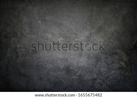 Black grungy faded stucco, concrete and cement pattern, Textured Background.