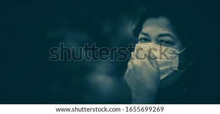 Covid-19 Coronavirus concept.Senior old woman wearing N95 mask for protect virus Covid-19.Social distancing.Healthcare medical mental health.Sickness indian old woman infected.Banner background. Royalty-Free Stock Photo #1655699269