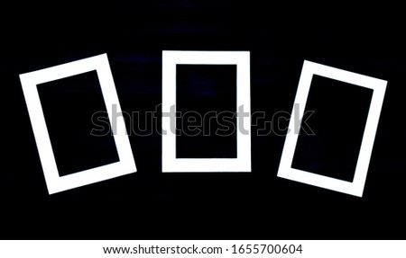 Conceptual image of frames with square shapes minimalist design and modern style black and white wooden backgrounds
