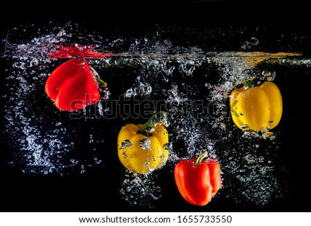 bell peppers falling into the splash water,three assorted-color peppers,red pepper,two red peppers,green, yellow, and red bell peppers,close-up photography of bell pepper,Vegetable #1655733550