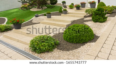 Front yard with modern outside stairs made of concrete paving Royalty-Free Stock Photo #1655743777