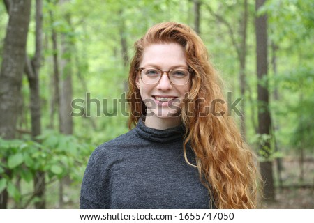 Young adult profile picture with red hair.