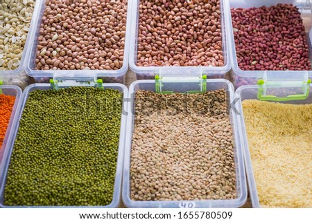 general plan of the store counter, with containers filled with a variety of cereals, cereals. Raw cereals. Healthy nutrition, natural nutrition. diet food #1655780509