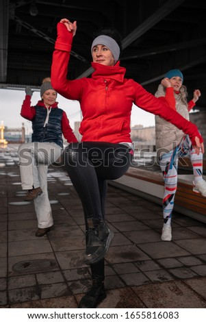 Middle Aged Women Exercising Outdoors In Winter Time. Living Full Life At Senior Age #1655816083