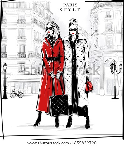 Hand drawn two beautiful young women in sunglasses. Fashion women with Paris street background. Girls in fashion clothes. Sketch. Fashion illustration.