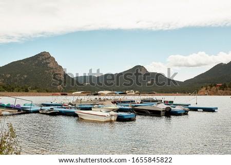 Mountains surrounding Lake Estes Reservoir and Recreation on a Fall day in Estes Park, Colorado.   #1655845822