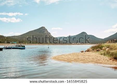 Mountains surrounding Lake Estes Reservoir and Recreation on a Fall day in Estes Park, Colorado.   #1655845825