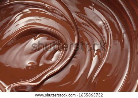 Melted dark chocolate swirl background