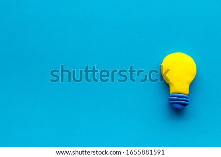 Invention concept. Bulb icon on blue background top-down copy space