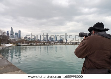 Male photographer taking panoramic pictures of Chicago and Lake Michigan