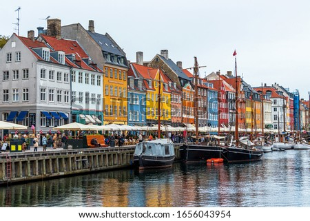 COPENHAGEN, DENMARK - View of colorful buildings lining the waterfront in Nyhavn, a 17th-century canal and entertainment district in Copenhagen, Denmark. #1656043954