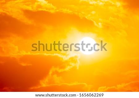 Blurred sunset on golden cloud background on sky summer season #1656062269