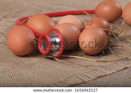 Eggs with stethoscope on linen background. Good nutrition for health. Nutrition concept.  #1656063127