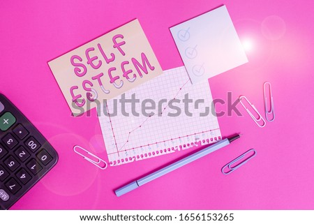 Handwriting text writing Self Esteem. Concept meaning a feeling of having respect for yourself and your abilities Stationary and note paper plus math sheet with diagram picture on the table.
